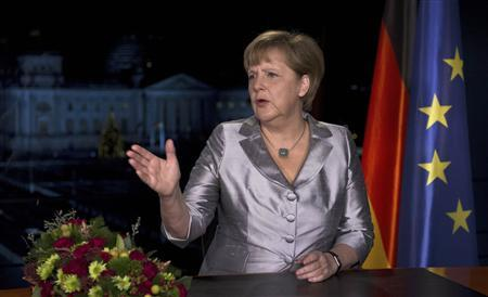 German Chancellor Angela Merkel poses for photographs after the recording of her annual New Year's speech at the Chancellery in Berlin December 30, 2012. REUTERS/John Macdougall/Pool