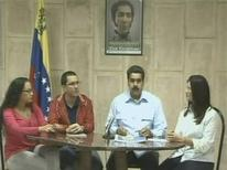 "A still image taken from Venezuelan government TV broadcast shows Venezuela's Vice President Nicolas Maduro (C) talking to the media during a news conference next to Venezuelan President Hugo Chavez' daughter Rosa Virginia (L), Technology Minister Jorge Arreaza (2nd L) and Attorney General Cilia Flores (R) in Havana December 30, 2012. Chavez has suffered more complications following complex cancer surgery in Cuba and remains in a ""delicate"" condition, Maduro said on Sunday. REUTERS/Venezuelan Government TV/Handout"