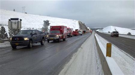 Rescue personnel respond to the scene of a charter bus crash on I-84, east of Pendleton, Oregon in this December 30, 2012 handout photo. REUTERS/Oregon State Police/Handout