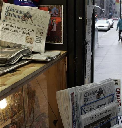 A newspaper stand in downtown Chicago selling the Chicago Tribune in Chicago, Illinois December 8, 2008. REUTERS/Frank Polich/Files