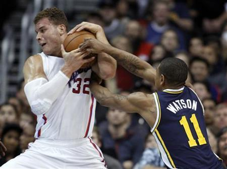Utah Jazz guard Earl Watson (11) attempts to steal the ball away from Los Angeles Clippers forward Blake Griffin during the first half of their NBA basketball game in Los Angeles, California December 30, 2012. REUTERS/Alex Gallardo