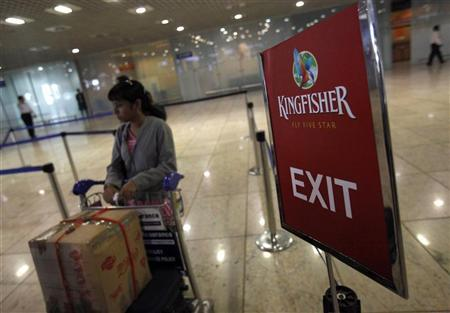 A lone Kingfisher Airlines customer waits in a check-in queue at Mumbai's domestic airport February 21, 2012. REUTERS/Vivek Prakash/Files