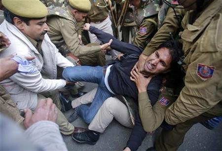 Police detain a demonstrator during a protest in New Delhi December 30, 2012. The body of a woman whose gang rape provoked protests and rare national debate about violence against women in India arrived back in New Delhi early on Sunday and was quickly cremated at a private ceremony. The unidentified 23-year-old medical student died from her injuries on Saturday, prompting promises of action from a government that has struggled to respond to public outrage. She had suffered brain injuries and massive internal injuries in the attack on December 16, and died in hospital in Singapore where she had been taken for treatment. REUTERS/Danish Siddiqui (INDIA - Tags: CRIME LAW CIVIL UNREST TPX IMAGES OF THE DAY)