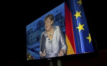 German Chancellor Angela Merkel is seen on a TV monitor in a nearby room as she prepares to record her annual New Year's speech at the Chancellery in Berlin December 30, 2012. EDITORS NOTE - PICTURE EMBARGOED UNTIL 23:01GMT DECEMBER 30, 2012. REUTERS/John Macdougall/Pool (GERMANY - Tags: POLITICS) TEMPLATE OUT.
