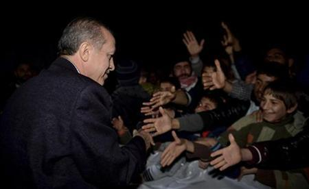 Turkish Prime Minister Tayyip Erdogan shakes hands with Syrian refugees as he visits a refugee camp near Akcakale border crossing on the Turkish-Syrian border, southern Sanliurfa province, December 30, 2012. REUTERS/Kayhan Ozer/Prime Minister's Press Office/Handout (TURKEY - Tags: POLITICS CONFLICT) FOR EDITORIAL USE ONLY. NOT FOR SALE FOR MARKETING OR ADVERTISING CAMPAIGNS. THIS IMAGE HAS BEEN SUPPLIED BY A THIRD PARTY. IT IS DISTRIBUTED, EXACTLY AS RECEIVED BY REUTERS, AS A SERVICE TO CLIENTS