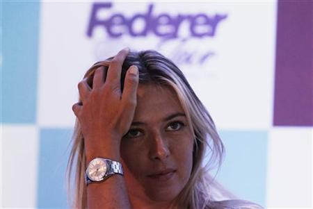 Tennis player Maria Sharapova of Russia attends a news conference, ahead of an exhibition tour in Sao Paulo December 6, 2012. REUTERS/Nacho Doce/Files