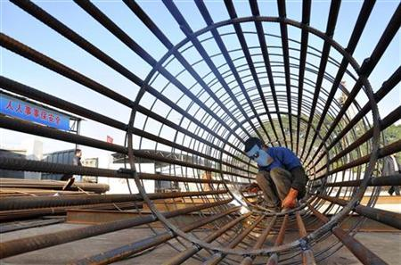 A worker welds steel bars at a construction site for a new train station in Ningbo, Zhejiang province, December 6, 2012. REUTERS/China Daily (CHINA - Tags: BUSINESS CONSTRUCTION TRANSPORT TPX IMAGES OF THE DAY) CHINA OUT. NO COMMERCIAL OR EDITORIAL SALES IN CHINA