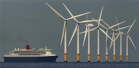 The cruise liner Queen Mary 2 passes the Burbo Bank off-shore wind farm as it heads to Liverpool, northern England September 15, 2011. REUTERS/Phil Noble