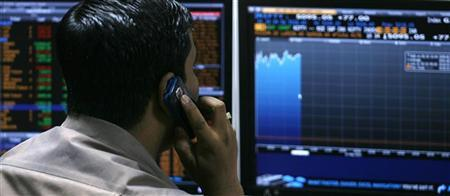 A broker looks at computer screens at a stock brokerage firm in Mumbai May 10, 2010. REUTERS/Arko Datta/Files