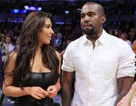 Reality TV star Kim Kardashian (L) and U.S. rapper Kanye West watch the Los Angeles Lakers play the Denver Nuggets during Game 7 of their NBA Western Conference basketball playoff series in Los Angeles, California in this May 12, 2012 file photo. REUTERS/Lucy Nicholson/Files