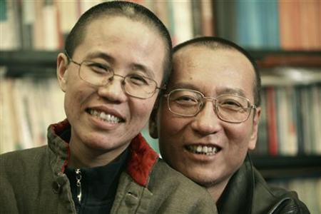 Chinese dissident Liu Xiaobo and his wife Liu Xia pose in this undated photo released by his family on October 3, 2010. REUTERS/Handout/Files