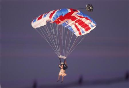 A parachutist dressed as Queen Elizabeth is seen during the opening ceremony of the London 2012 Olympic Games at the Olympic Stadium July 27, 2012. REUTERS/Jorge Silva