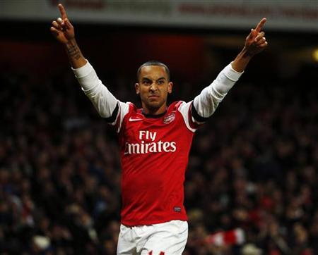 Arsenal's Theo Walcott celebrates his second goal against Newcastle United during their English Premier League soccer match at The Emirates stadium in London December 29, 2012. REUTERS/Eddie Keogh