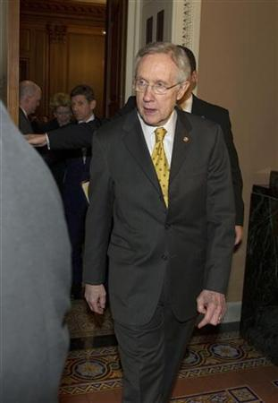 Senate Majority Leader Harry Reid (D-NV) leaves the Mansfield Room after a caucus meeting at the U.S. Capitol in Washington December 30, 2012. REUTERS/Mary Calvert