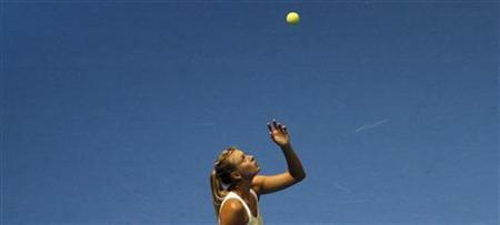 Maria Sharapova of Russia tosses a ball during her match against Caroline Wozniacki of Denmark in an exhibition tour in Sao Paulo December 7, 2012. REUTERS/Nacho Doce