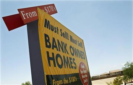 A sign offering bank owned homes for sale is seen in a subdivision in Maricopa, Arizona in this file photo from May 27, 2009. REUTERS/Joshua Lott/Files