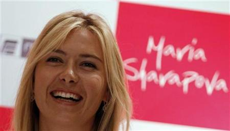 Tennis player Maria Sharapova of Russia smiles at a news conference during a promotional event for Homestead infrastructure company in New Delhi November 11, 2012. REUTERS/Vijay Mathur