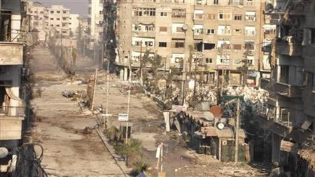 A view of buildings damaged by what activists said were missiles fired by a Syrian Air Force fighter jet loyal to President Bashar al-Assad in Daraya, near Damascus, December 29, 2012. REUTERS/Kenan Al-Derani/Shaam News Network/Handout