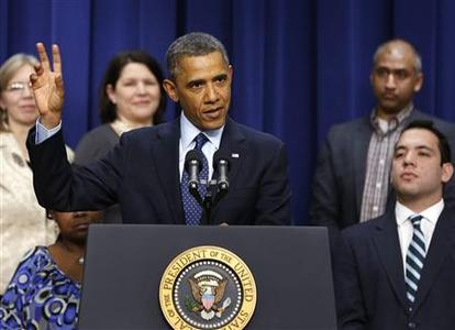 U.S. President Barack Obama speaks about the negotiations with Capitol Hill on the looming fiscal cliff in front of middle class Americans while in the Eisenhower Executive Office Building on the White House complex in Washington, December 31, 2012. REUTERS/Larry Downing