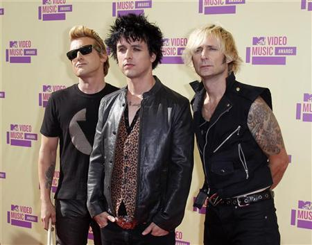 The Rock group Green Day, Mike Dirnt, (L), Billie Joe Armstrong, (C), and Tre Cool arrive for the 2012 MTV Video Music Awards in Los Angeles, September 6, 2012. REUTERS/Danny Moloshok