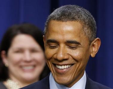 U.S. President Barack Obama smiles while he discusses the negotiations with Capitol Hill on the looming fiscal cliff in front of middle class Americans while in the Eisenhower Executive Office Building on the White House complex in Washington, December 31, 2012. U.S. Senate leaders were hammering out a last-minute deal to avoid the ''fiscal cliff'' on Monday, but it was still unclear if rank-and-file lawmakers would back the agreement, particularly those in the Republican-led House of Representatives. REUTERS/Larry Downing
