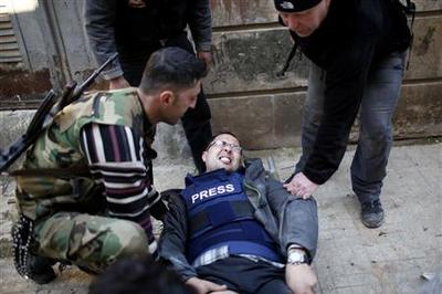 Reuters TV cameraman wounded in Syria