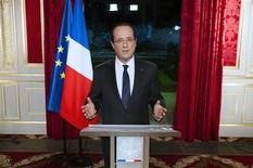 France's President Francois Hollande gestures as he arrives to deliver his New Year's speech at the Elysee Palace in Paris, December 31, 2012. REUTERS/Lionel Bonaventure/Pool