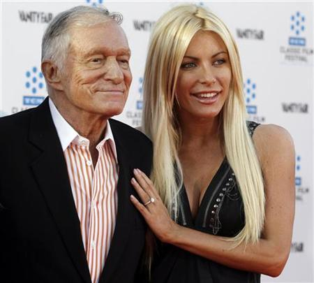 Hugh Hefner and his fiancee, Playboy Playmate Crystal Harris, arrive at the opening night gala of the 2011 TCM Classic Film Festival featuring a screening of a restoration of 'An American In Paris' in Hollywood, California April 28, 2011. REUTERS/Fred Prouser/Files