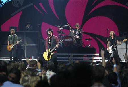 Green Day lead vocalist and guitarist Billie Joe Armstrong (C) and band members perform during the 2012 iHeart Radio Music Festival at the MGM Grand Garden Arena in Las Vegas, Nevada September 21, 2012. REUTERS/Steve Marcus/Files