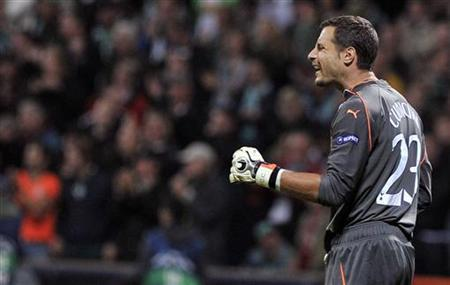 Tottenham Hotspur's goalkeeper Carlo Cudicini reacts after he failed to save a ball during their Champions League Group A soccer match against Werder Bremen in the northern German city of Bremen September 14, 2010. REUTERS/Morris Mac Matzen