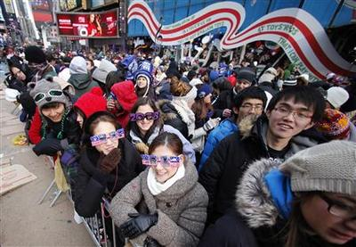 Revelers gather in NY's frigid Times Square on New...