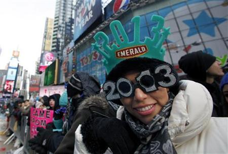 Sandra Anaya of Mexico City shows off her glasses as New Year's revellers begin to fill up Times Square in New York, December 31, 2012. REUTERS/Gary Hershorn