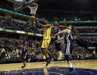 Indiana Pacers center Roy Hibbert puts up a shot defended by Memphis Grizzlies guard Mike Conley (L), Grizzlies forward Rudy Gay (2nd R) and Grizzlies center Marc Gasol (R) of Spain during the fourth quarter of an NBA basketball game in Indianapolis, Indiana December 31, 2012. REUTERS/Brent Smith