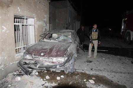 An Iraqi Kurd Asaish stands near the site of a car bomb attack in Kirkuk, 250 km (155 miles) north of Baghdad, December 31, 2012. REUTERS/Ako Rasheed