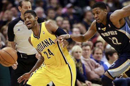 Indiana Pacers guard Paul George (24) and Memphis Grizzlies forward Rudy Gay (22) chase the ball during the fourth quarter of their NBA basketball game in Indianapolis, Indiana December 31, 2012. REUTERS/Brent Smith