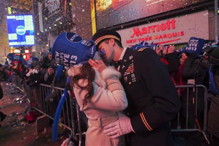 National Guardsman John Cebak (R) kisses his fiancee Sonja Babic at the start of the new year in Times Square in New York January 1, 2013. REUTERS/Keith Bedford