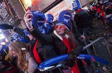 Revelers celebrate the start of the new year in Times Square in New York January 1, 2013. REUTERS/Keith Bedford