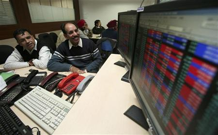 Investors watch a display at a local share market in Chandigarh December 18, 2008. REUTERS/Ajay Verma/Files