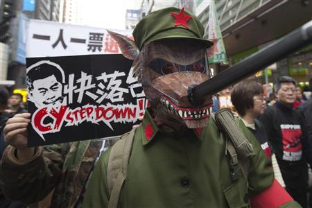 A protester dresses as a cultural revolution red guard wearing a wolf mask during a protest urging Hong Kong's Chief Executive Leung Chun-ying to step down in Hong Kong January 1, 2013. REUTERS/Tyrone Siu