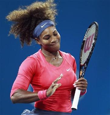 Serena Williams of the U.S. reacts after missing a shot against Alize Cornet of France during their women's singles match at the Brisbane International tennis tournament January 1, 2013. REUTERS/Daniel Munoz