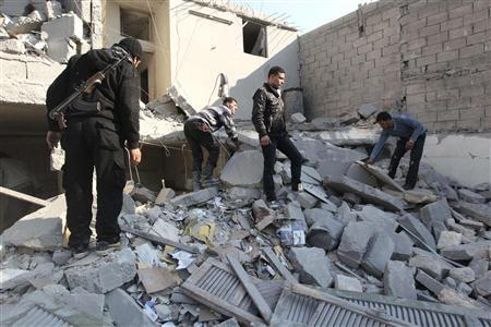 Free Syrian Army fighters and civilians search for bodies under rubble after an air strike by a fighter jet loyal to Syrian President Bashar al-Assad in Aleppo's al-Marja district December 31, 2012. REUTERS/Muzaffar Salman (SYRIA - Tags: CONFLICT POLITICS CIVIL UNREST)