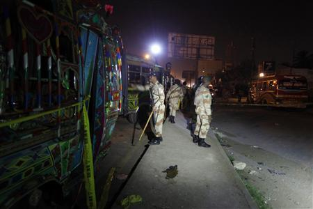 Soldiers cordon off the site of a motorcycle bomb blast in Karachi January 1, 2013. REUTERS/Akhtar Soomro