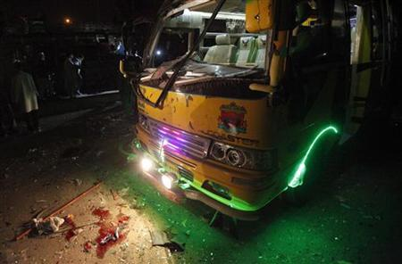 Blood is seen near a bus at a bomb blast site in Karachi January 1, 2013. REUTERS/Athar Hussain