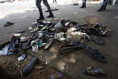Shoes are seen along a street in Plateau district where a stampede occurred after a New Year's Eve fireworks display in Abidjan January 1, 2013. About 60 people were crushed to death in a stampede outside a stadium in Ivory Coast's main city of Abidjan after a New Year's Eve fireworks display, the government said on Tuesday. The incident took place near Felix Houphouet Boigny Stadium where a crowd had gathered to watch fireworks, emergency officials said. REUTERS/Thierry Gouegnon