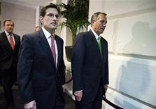 """Speaker of the House John Boehner (R-OH) walks with House Majority Leader Rep. Eric Cantor (R-VA) to a meeting with House Republicans on the """"fiscal cliff"""" budget deal on Capitol Hill in Washington on January 1, 2013. Washington's last-minute scramble to step back from a """"fiscal cliff"""" ran into trouble on Tuesday as Republicans in the House of Representatives balked at a deal to avert a budget crisis. REUTERS/Joshua Roberts"""