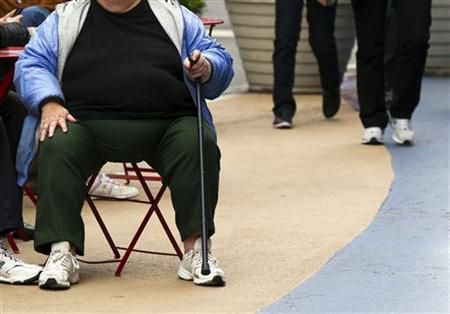 An overweight woman sits on a chair in Times Square in New York, May 8, 2012. REUTERS/Lucas Jackson
