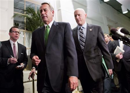 Speaker of the House John Boehner (R-OH) (front, in green tie) walks with Congressman Dave Camp (R-MI) (R) after a meeting with House Republicans about a ''fiscal cliff'' deal on Capitol Hill in Washington January 1, 2013. REUTERS/Joshua Roberts