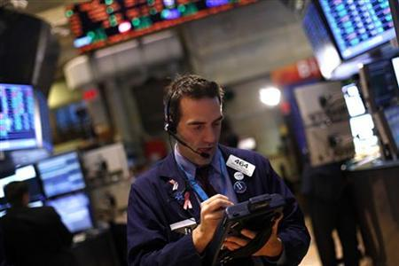 A trader works on the floor of the New York Stock Exchange during the final day of trading of 2012 in New York, December 31, 2012. REUTERS/Joshua Lott