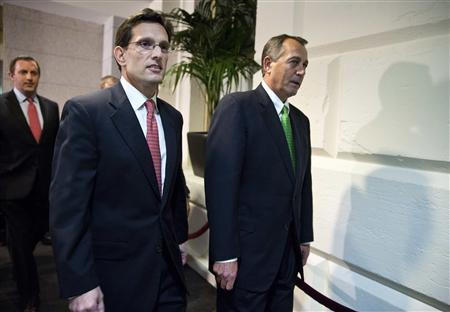 Speaker of the House John Boehner (R-OH) walks with House Majority Leader Rep. Eric Cantor (R-VA) to a meeting with House Republicans on the ''fiscal cliff'' budget deal on Capitol Hill in Washington on January 1, 2013. REUTERS/Joshua Roberts
