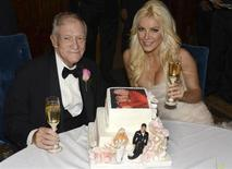 Octogenarian Playboy founder Hugh Hefner poses with his bride Crystal Harris at their New Year Eve wedding at the Playboy Mansion in Beverly Hills, California in this handout photo taken on December 31, 2012. REUTERS/Elayne Lodge/PEI/Handout